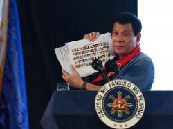 Fratel Jun, il missionario fotografo che denuncia Duterte